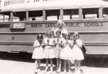 1964/65 Sandy Mush School - girls and teacher in front of school bus